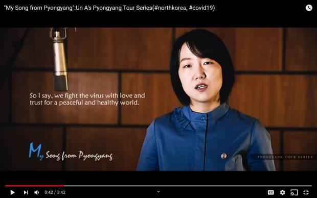 '평양에서의 내 노래'라는 제목의 동영상에서 코로나19의 고통 받는 사람들을 위로하기 위해 노래한다고 말하는  '은아'라는 이름의 여성.